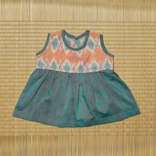 nayumi pepe and nika baby dress with bloomers in green orange handmade and handwoven cotton made in indonesia